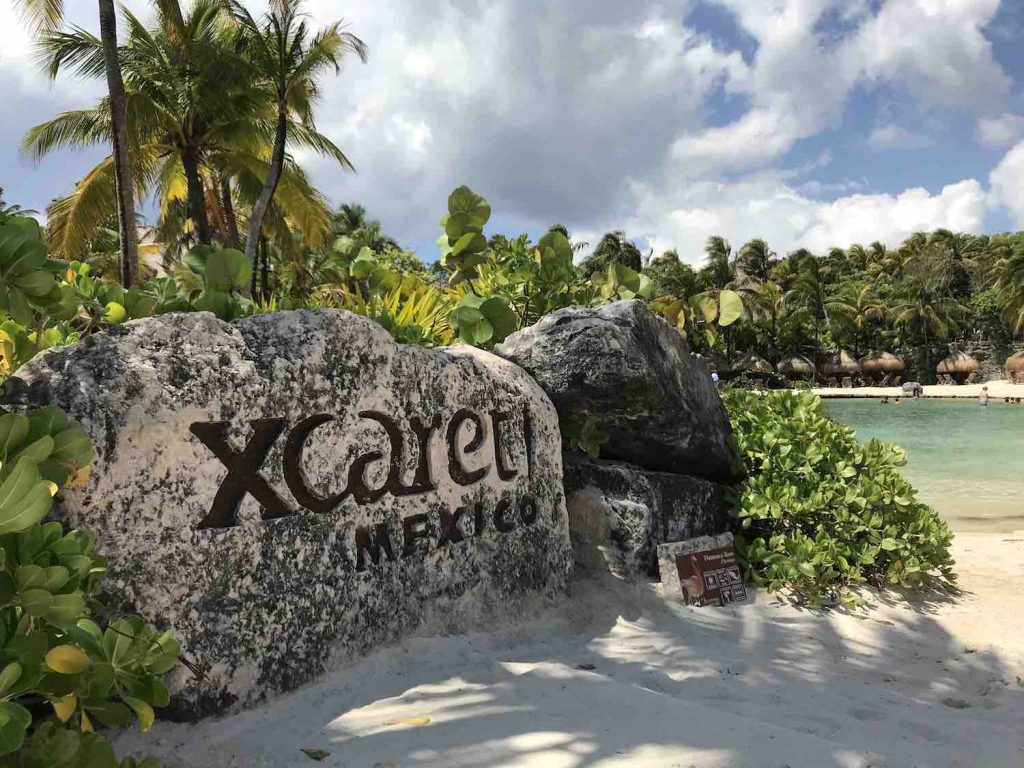 xcaret park sign at the beach